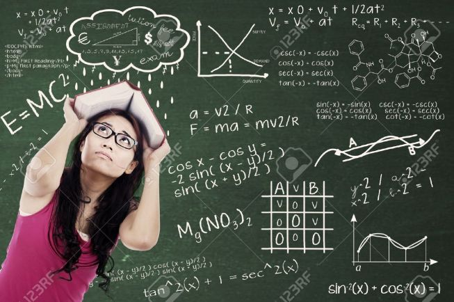 15071432-confused-college-student-with-formulas-on-the-blackboard-and-covering-her-head-by-textbook-shot-at-c