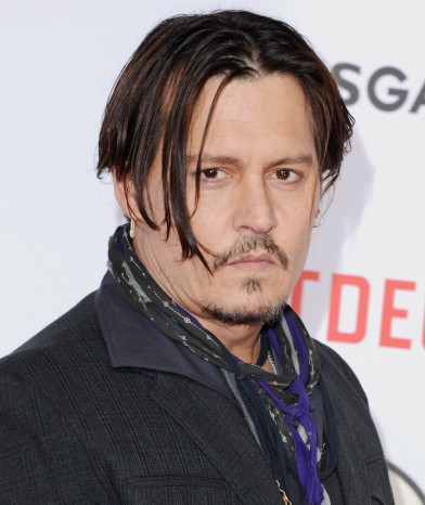 "HOLLYWOOD, CA - JANUARY 21:  Actor Johnny Depp arrives at the Los Angeles Premiere Of ""Mortdecai"" at TCL Chinese Theatre on January 21, 2015 in Hollywood, California.  (Photo by Jon Kopaloff/FilmMagic) ORG XMIT: 532490963 ORIG FILE ID: 461934020"