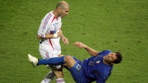 A photo taken 09 July 2006 shows French midfielder Zinedine Zidane (L) gesturing after head-butting Italian defender Marco Materazzi during the World Cup 2006 final football match between Italy and France at Berlin?s Olympic Stadium.  AFP PHOTO  JOHN MACDOUGALL (Photo credit should read JOHN MACDOUGALL/AFP/Getty Images)